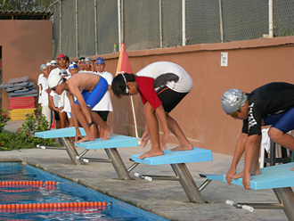 Competitive swimming in puerto vallarta at colegio mexico - How far is 50 lengths of a swimming pool ...