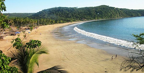 All Magic Aside The Fine Sand Beach Nestled Against Backdrop Of Lush Green Jungle On One Side And Hugged By Sparkling Waters Pacific